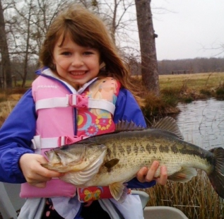 Mike Abbots daughter holds her personal best at Ben Wheeler Twin Lakes. At this rate, she will be catching 10 pounders by the time she is 10 years old!