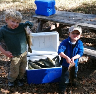 Member, Carl Jones sons showing off their cooler full of harvested fish at Sulphur Bluff Deer Trail. Thanks for helping us manage the lake boys!