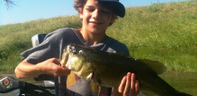 Eli Yancey holds his personal best, caught on a hot summer day at Weston SW Lake.