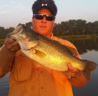 Mark Levock holds a 7 pounder caught at Van Alstyne JerMar Lake in mid-summer.