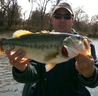 Jon Waters with a 6 lb plus fish caught on an early spring day at Decatur Beaver Lake.