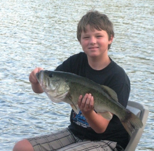 Owner, Steve Alexander's oldest son Ty, holds his personal best. Caught mid summer at Sash Fannin Farms.