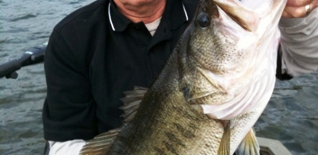 Ed Hueske holds a nice 8.5lb at Longbranch Yates Place.